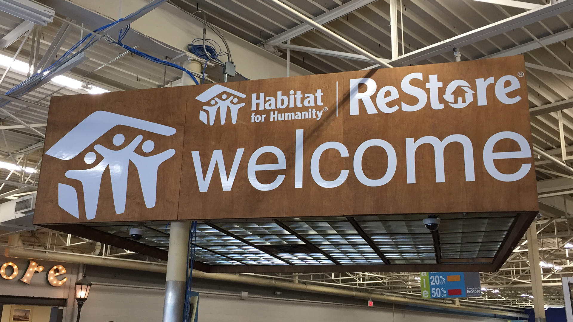 Habitat for humanity restore welcome sign